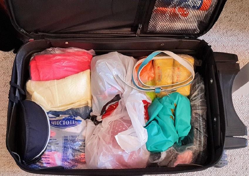 Упаковка вещей в чемодан